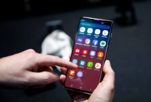 A Journalist Uses The New Samsung Galaxy S10 Smartphone At A Press Event In London
